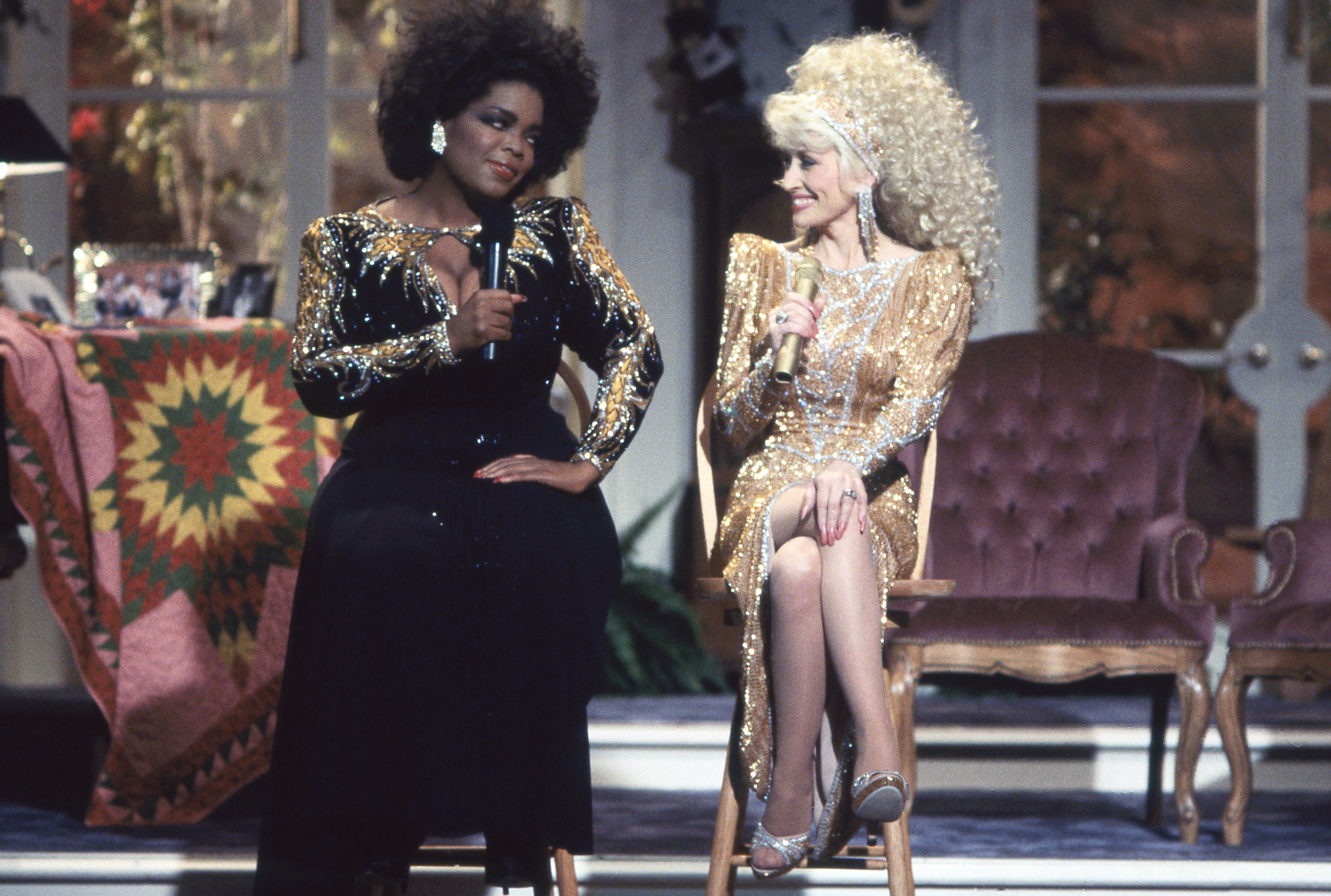 "Dolly Parton and Oprah Winfrey sit next to each other on the ""Dolly"" Variety Show in 1987 