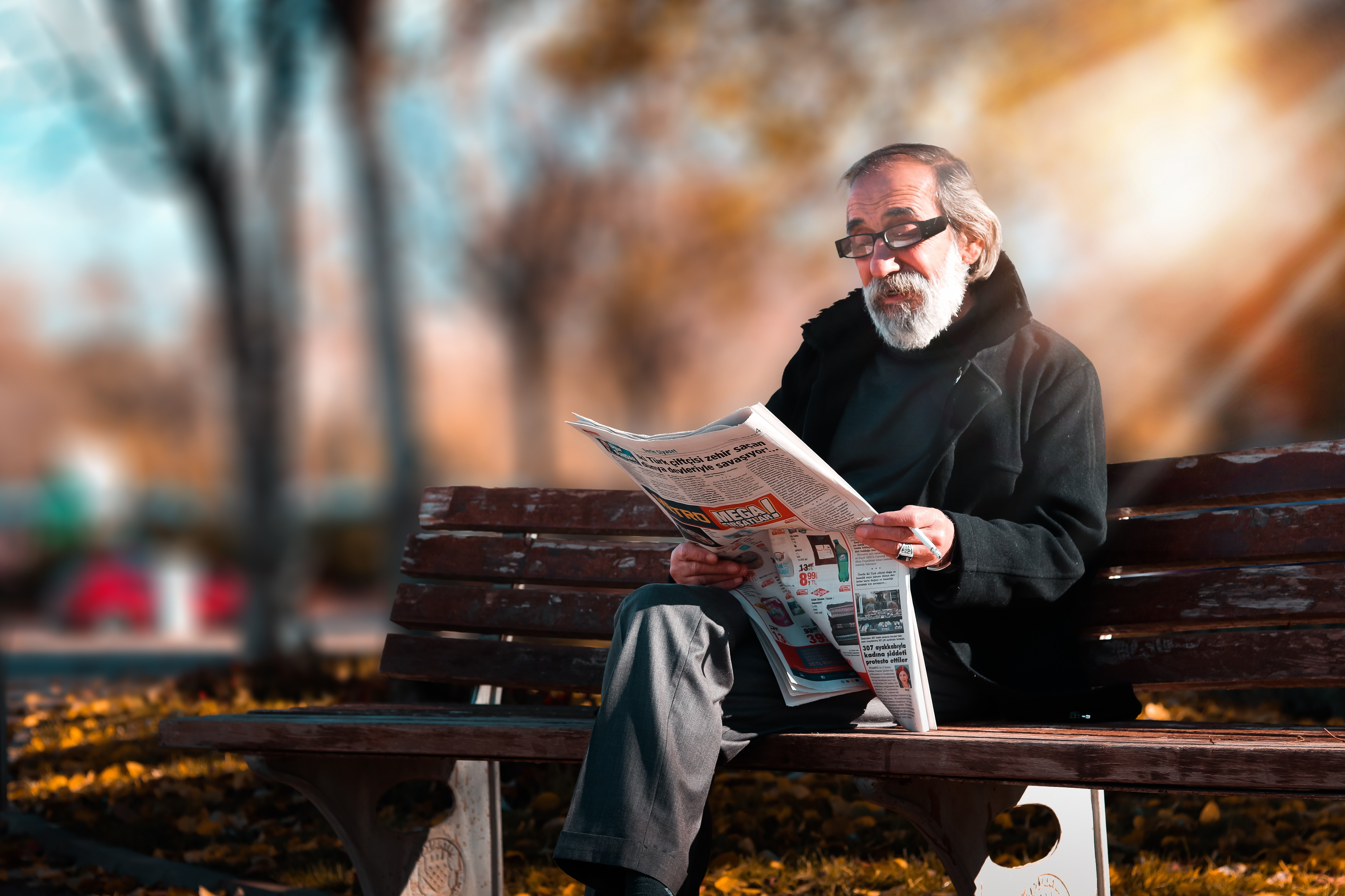 An old man reading a newspaper   Source: Pexels