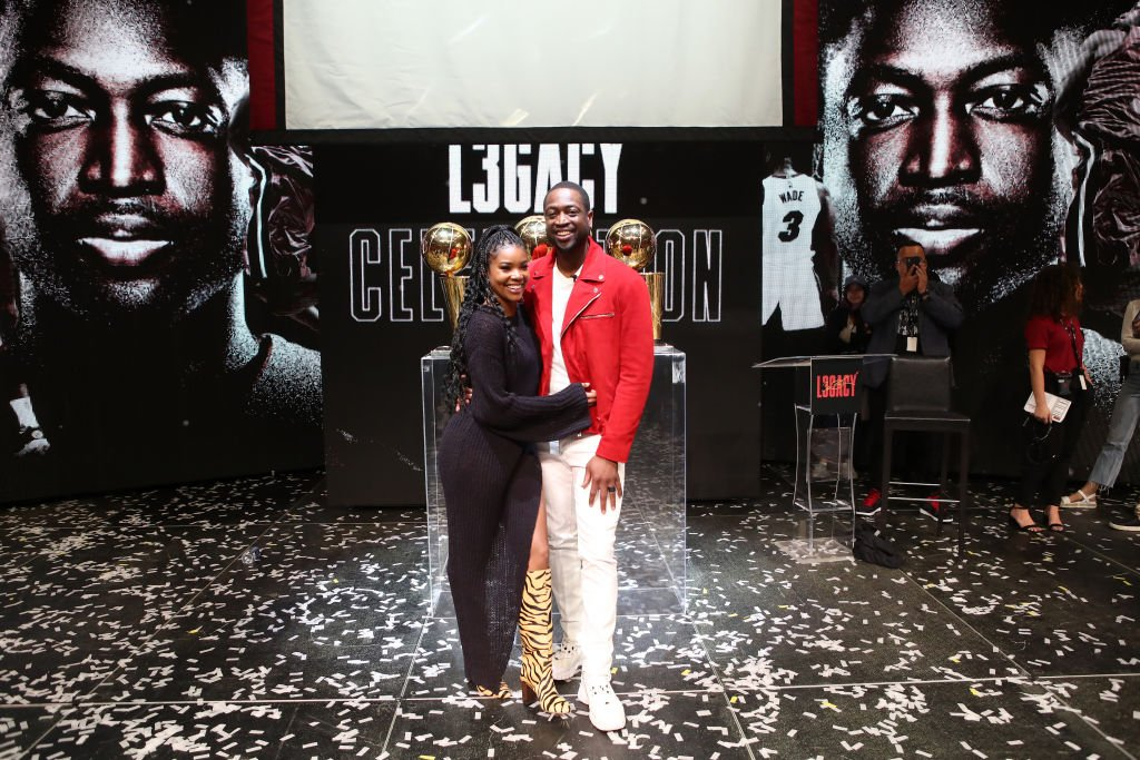 Dwyane Wade poses for a photo with his wife Gabrielle Union during the Jersey Retirement Flashback Event,2020| Photo: Getty Images