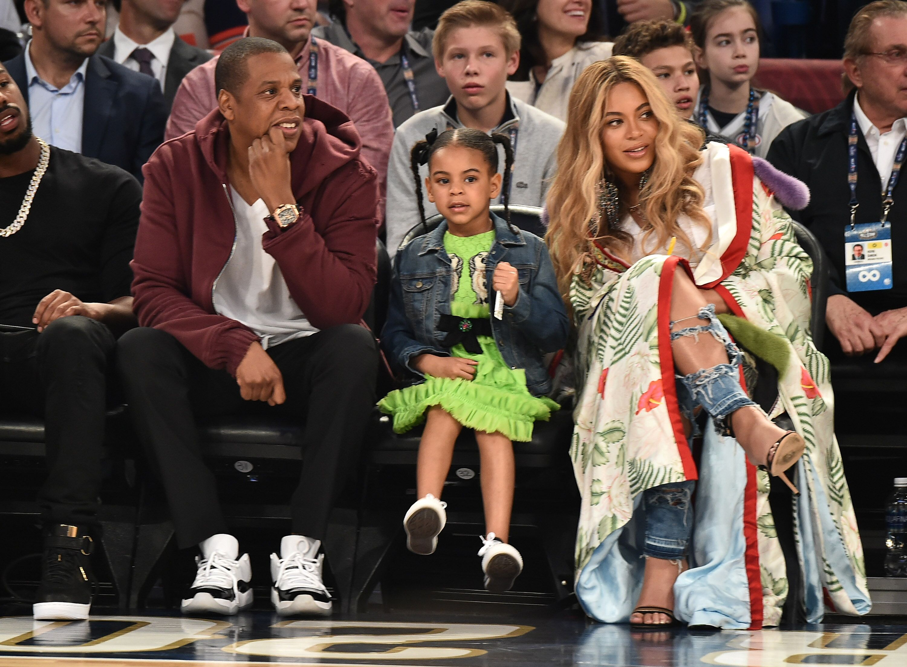 Singer Beyonce, rapper Jay-Z, and daughter Blue Ivy Carter at an NBA All Star game/ Source: Getty Images