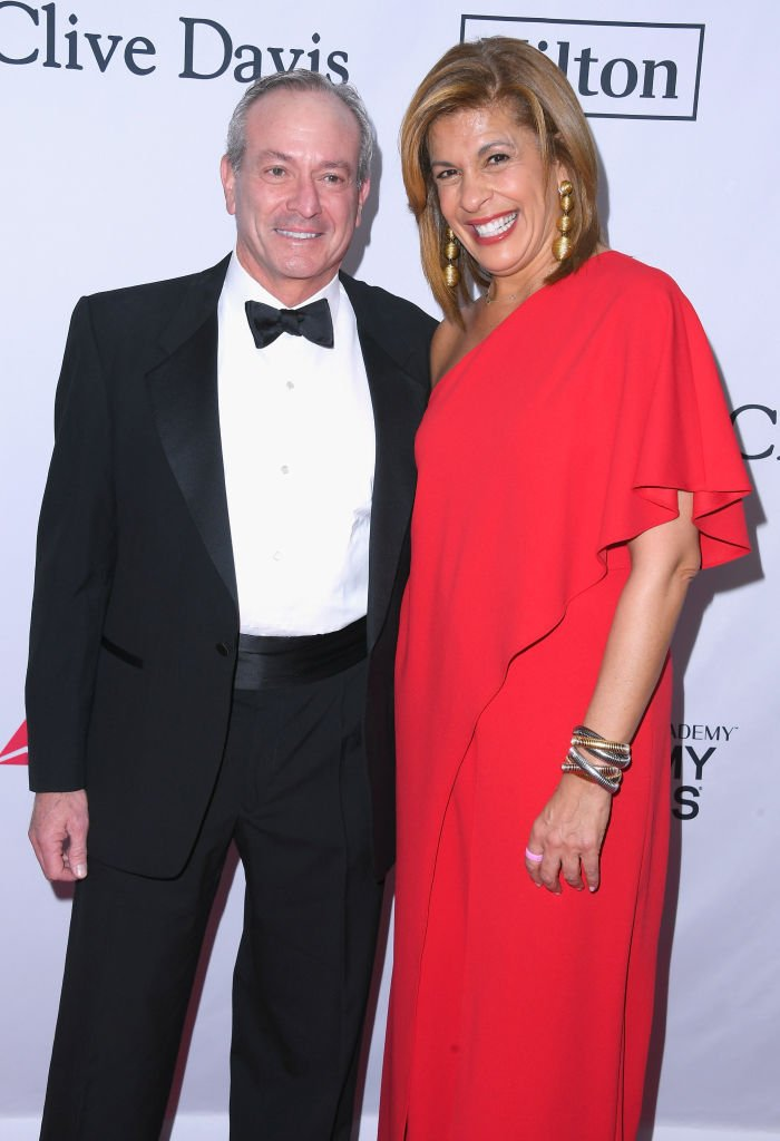 Financier Joel Schiffman (L) and journalist Hoda Kotb attend the Clive Davis and Recording Academy Pre-GRAMMY Gala and GRAMMY Salute to Industry Icons Honoring Jay-Z | Photo: Getty Images