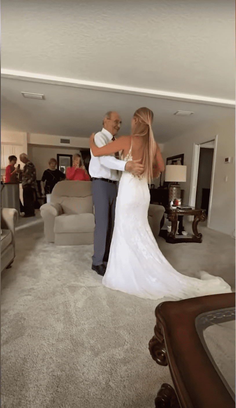 Bride who traveled over 600 miles to dance with her grandfather.   Photo: YouTube/SWNS