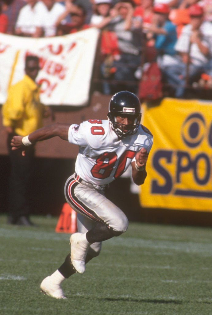 Andre Rison #80 of the Atlanta Falcons runs a pass rout against the San Francisco 49ers during an NFL Football game | Getty Images