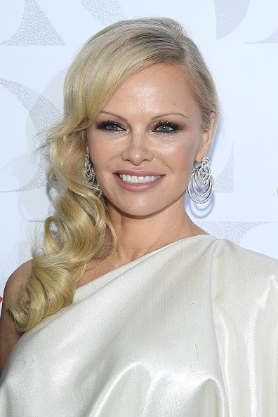 """Pamela Anderson at the 17th """"Diner De La Mode"""" as part of Paris Fashion Week on January 22, 2019 in Paris, France. 