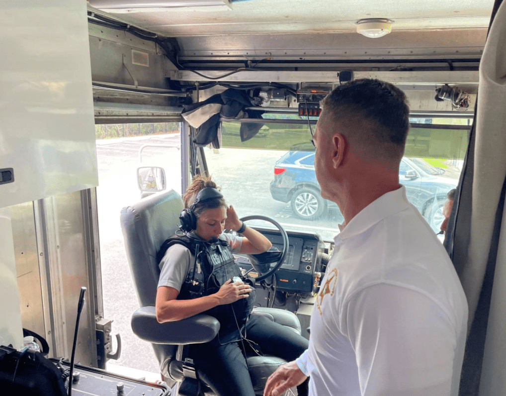 Pictured - Chronister with a fell law enforcement official in a police vehicle   Source: Facebook / SheriffChadChronister