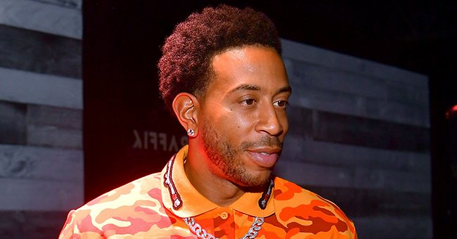 Ludacris' Oldest Daughter Karma Stuns in IG Snaps Wearing a White Bra & Red Floral Robe