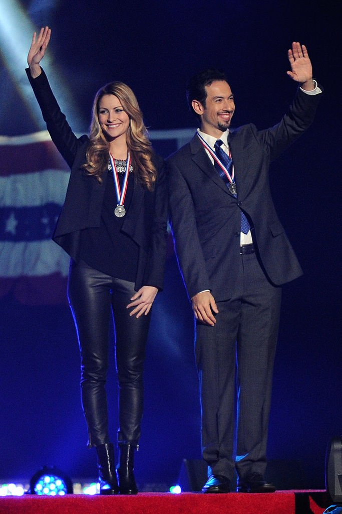 "Tanith Belbin and Ben Agosto are introduced during the P&G & Wal-Mart ""Tribute to American Legends of the Ice"" at Izod Center on December 11, 2013  