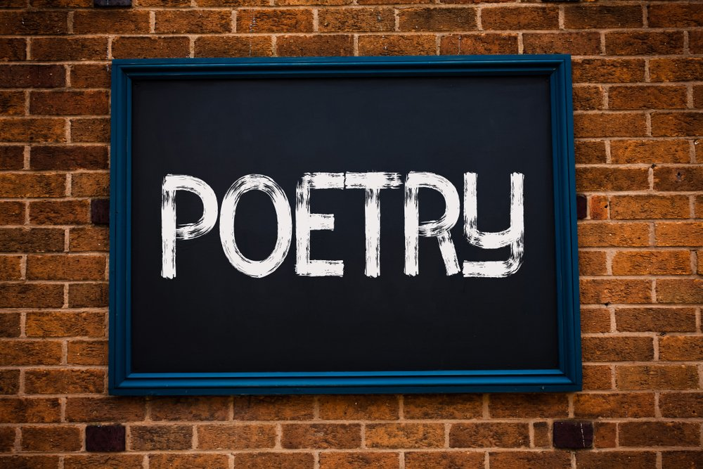 """Conceptual hand writing showing the word """"Poetry"""" written in a frame 