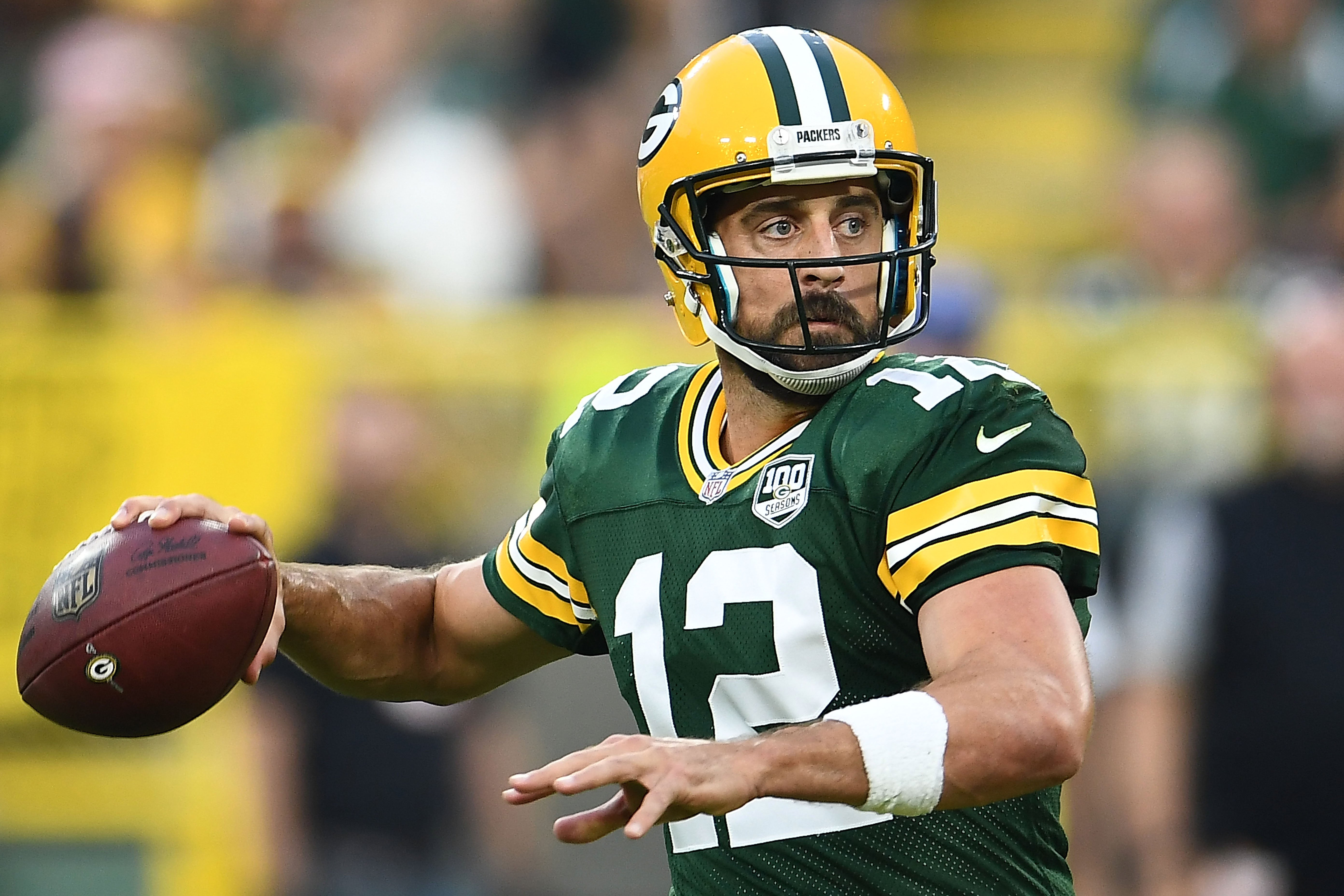 Aaron Rodgers #12 of the Green Bay Packers drops back to pass during a preseason game against the Pittsburgh Steelers at Lambeau Field on August 16, 2018 in Green Bay, Wisconsin   Photo: Getty Images