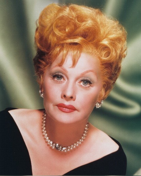 Lucille Ball wearing pearl earrings and a pearl necklace, in a studio portrait.  Photo: Getty Images.