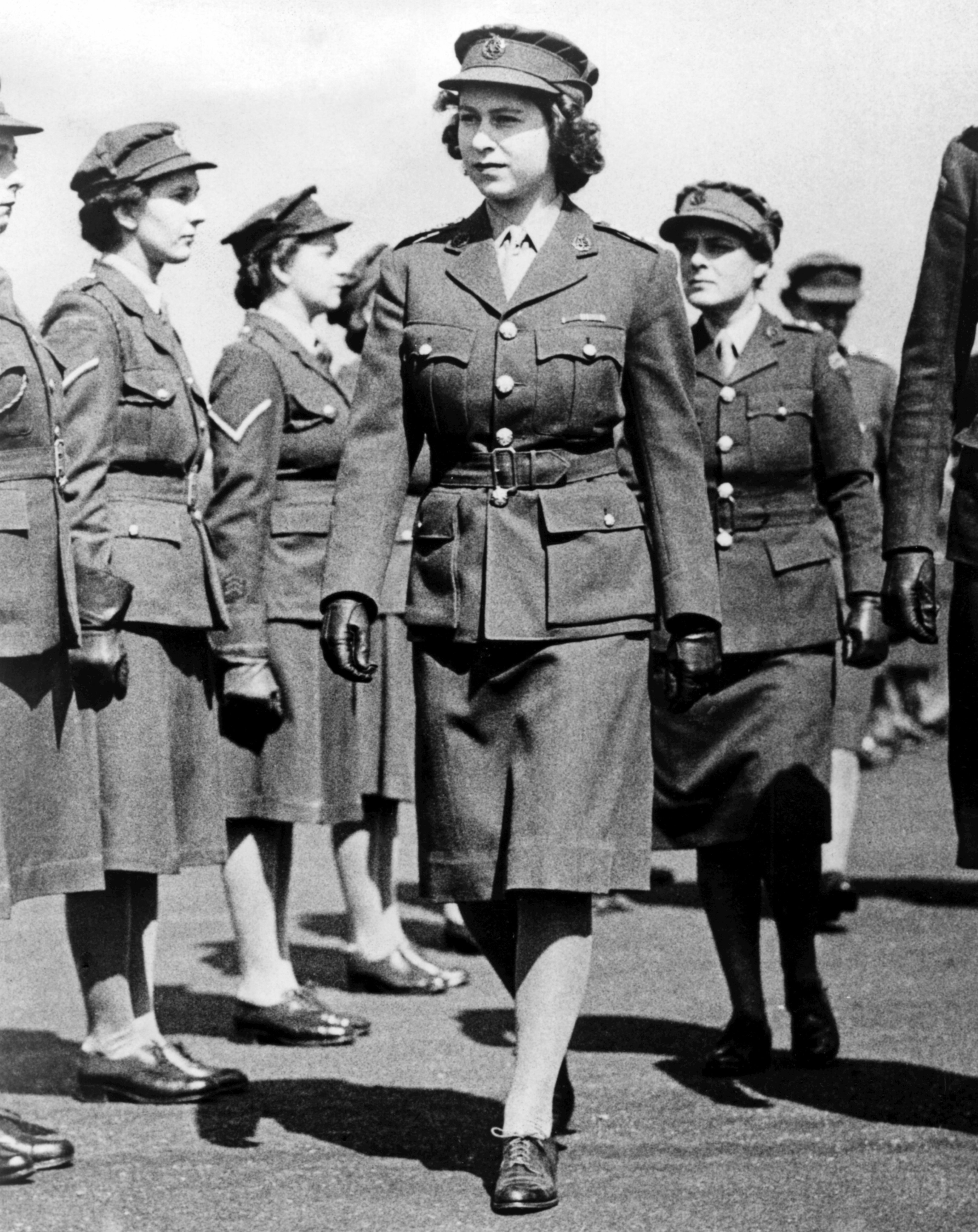 Princess Elizabeth as Junior Commander in the ATS inspecting The Motor Transport Training Centre at Camberley, Surrey during the Second World War. Circa May 1945. | Source: Getty Images
