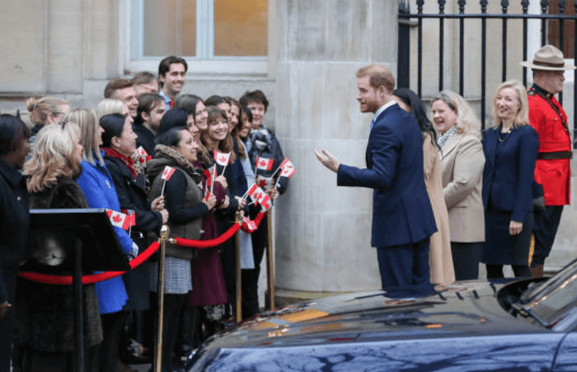 Prince Harry and Meghan Markle speak to a crowd of people as they arrive at Canada House, on January 2 2020, in London, England | Source:Steve Taylor/SOPA Images/LightRocket via Getty Images