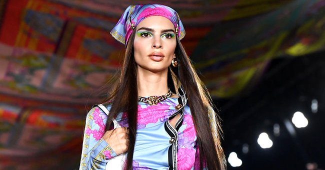Emily Ratajkowski walking the runway at the Versace fashion show during the Milan Fashion Week, September 2021 | Source: Getty Images