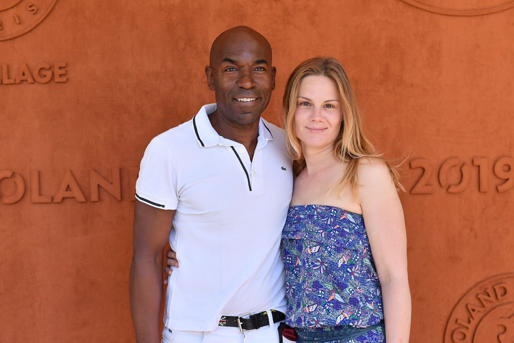 Lucien Jean-Baptiste et Aurelie Nollet assistent à l'Open de France de Tennis 2019 - Jour 8 à Roland Garros le 02 juin 2019 à Paris. | Photo : Getty Images