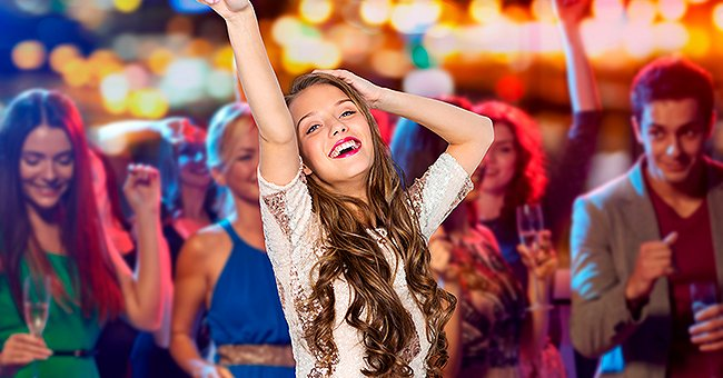 A young lady dancing at a party   Photo: Shutterstock