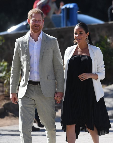 Prince Harry and Meghan walk through the walled public Andalusian Gardens during a visit on February 25, 2019, in Rabat, Morocco. | Source: Getty Images.