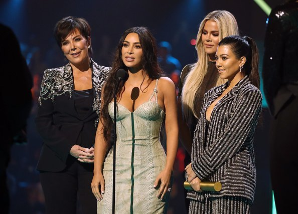 Kris Jenner, Kim Kardashian, Khloé Kardashian, and Kourtney Kardashian accept The Reality Show of 2019 for 'Keeping Up with the Kardashians' on stage during the 2019 E! People's Choice Awards held at the Barker Hangar on November 10, 2019 | Photo: Getty Images