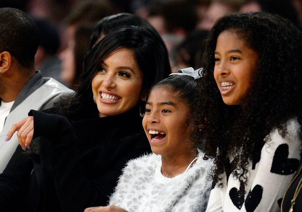 Wife Vanessa Laine Bryant (L) and daughters Gianna Bryant (C), 8, and Natalia Bryant watch Kobe Bryant #24 of the Los Angeles Lakers during the basketball game against Indiana Pacers at Staples Center | Photo: Getty Images