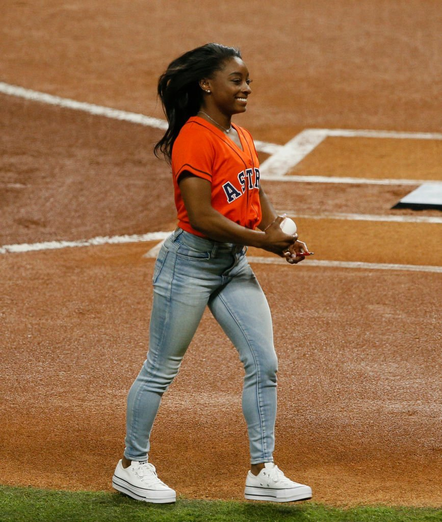 U.S. gymnast Simone Biles throws out the first pitch prior to Game Two of the 2019 World Series at Minute Maid Park | Photo: Getty Images
