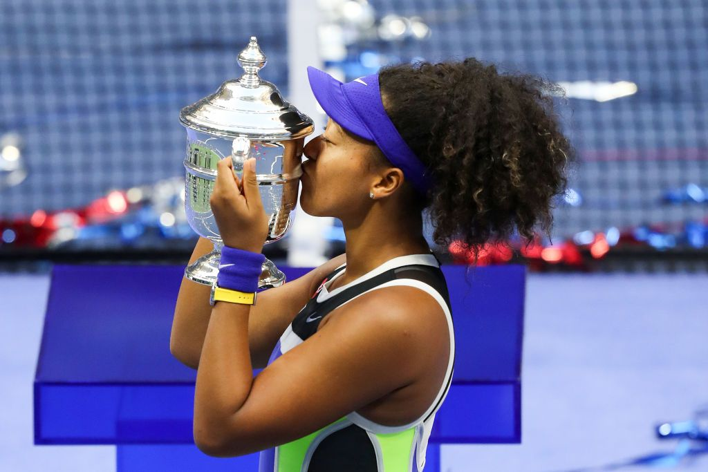 Naomi Osaka kissing the U.S. Open 2020 trophy after winning her Women's Singles finals match against Victoria Azarenkaat the USTA Billie Jean King National Tennis Center in New York City | Photo: Matthew Stockman/Getty Images