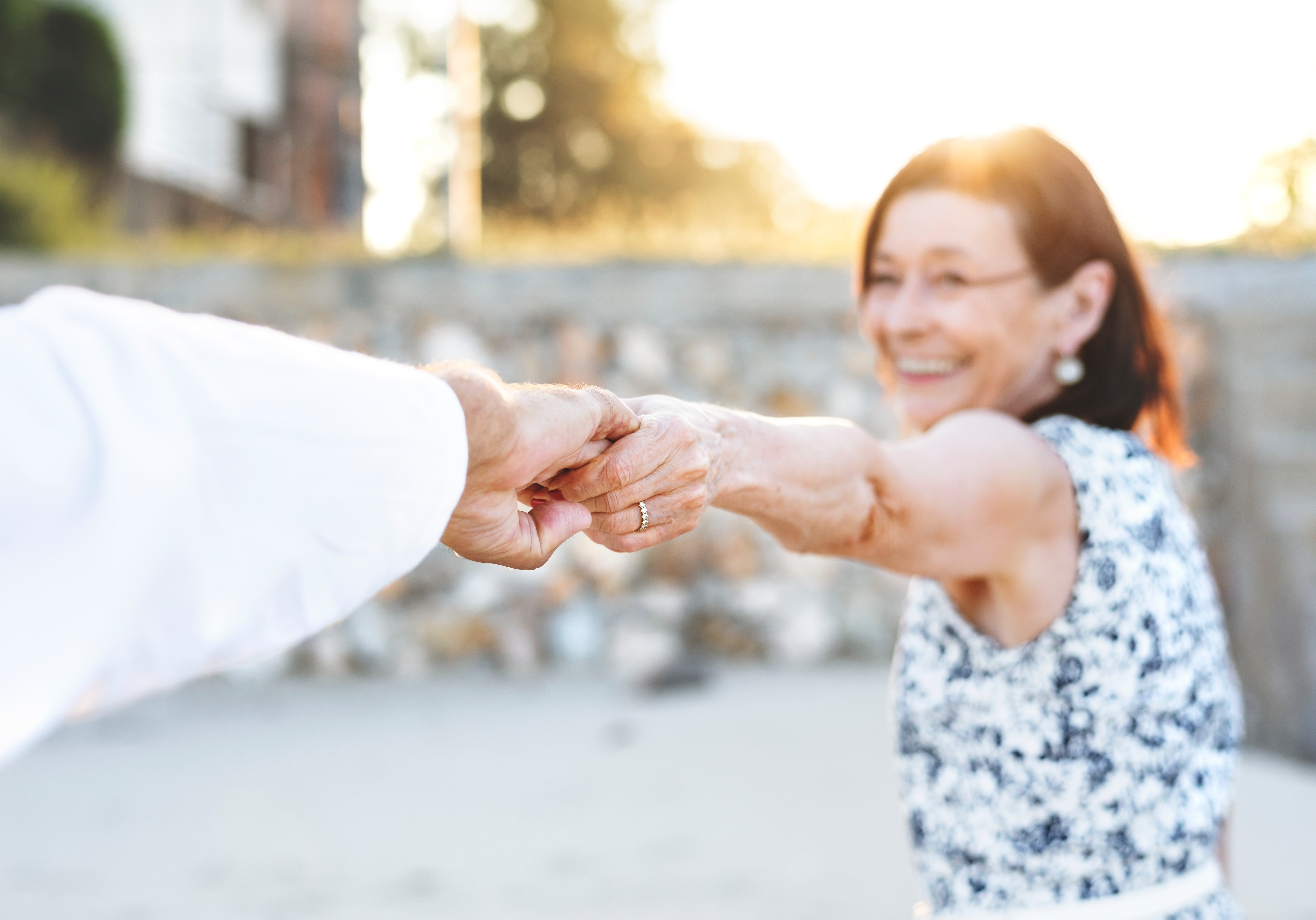 A pair of old man and woman holding hands.   Source: Pexels