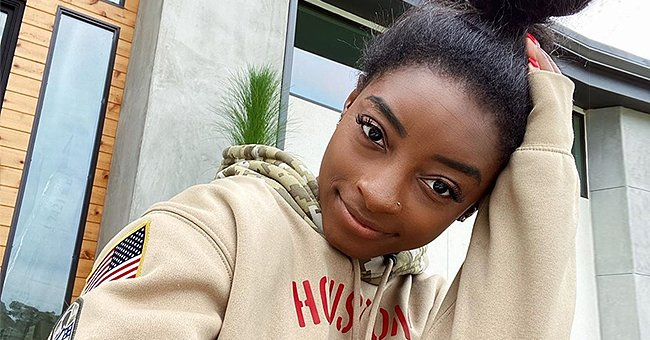 Simone Biles Looks Unbothered as She Sunbathes by the Pool in a New Bikini Photo