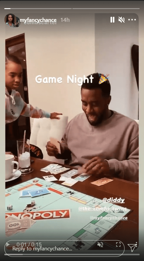 Sean Combs smiling during a game of Monopoly with his daughters | Photo: Instagram/myfancychance