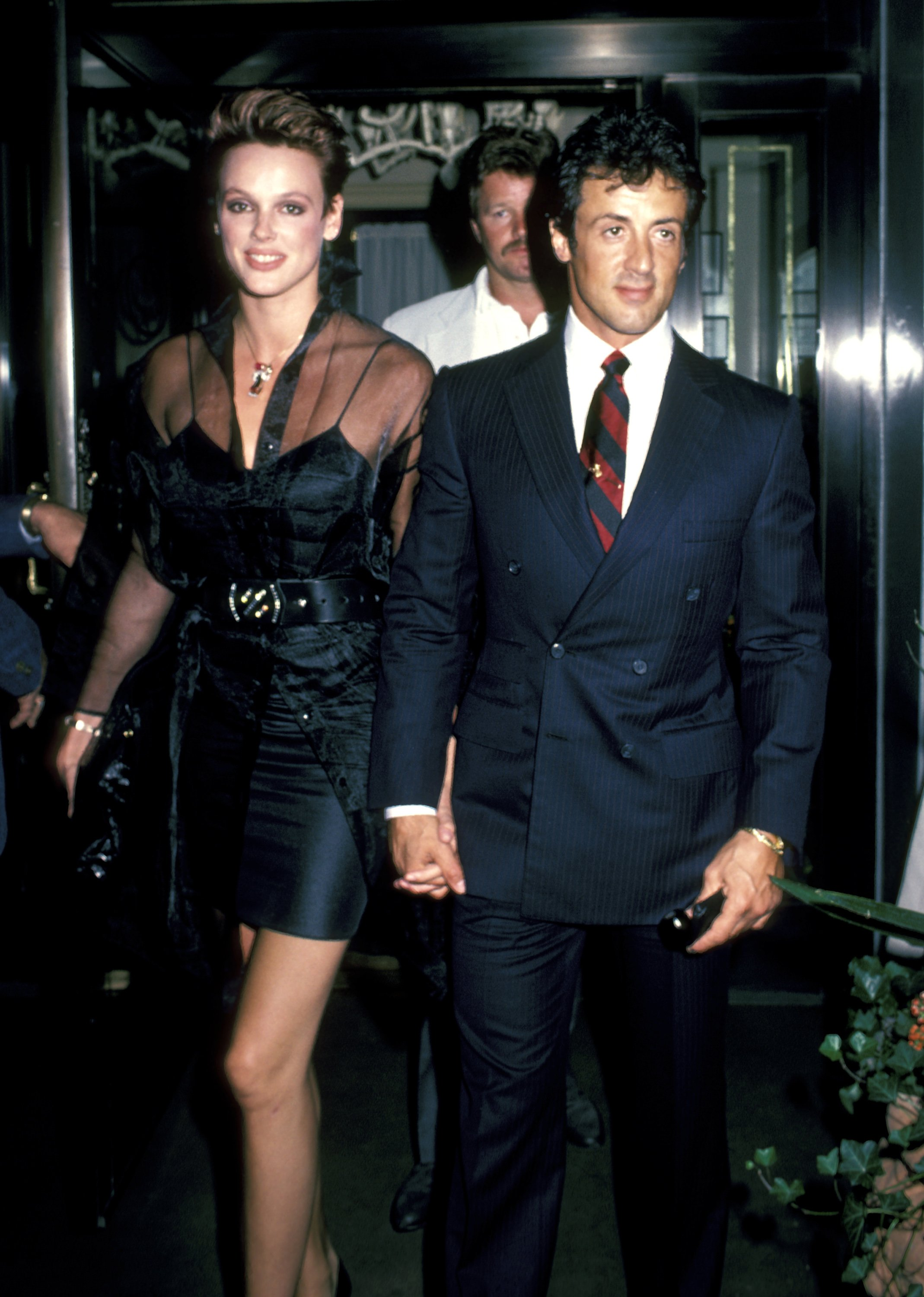 Brigitte Nielsen and Sylvester Stallone outside Le Cirque Restaurant in New York City - August 6, 1985 | Photo: Getty Images