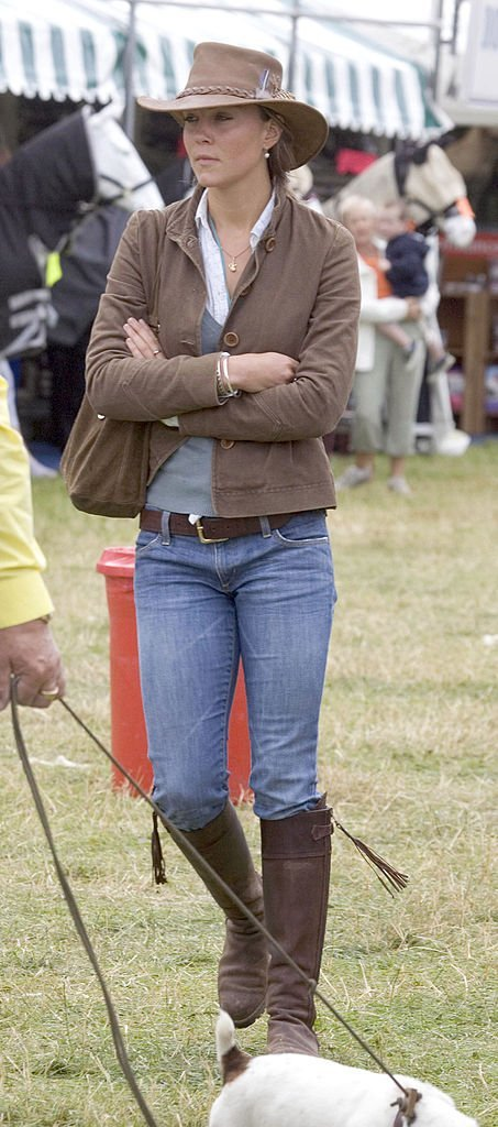 Kate Middleton walks through a tented area as she attended the second day of the Gatcombe Park Festival at Gatcombe Park, on August 6, 2005, in Tetbury, England | Source: Getty Images (Photo by Anwar Hussein/WireImage)