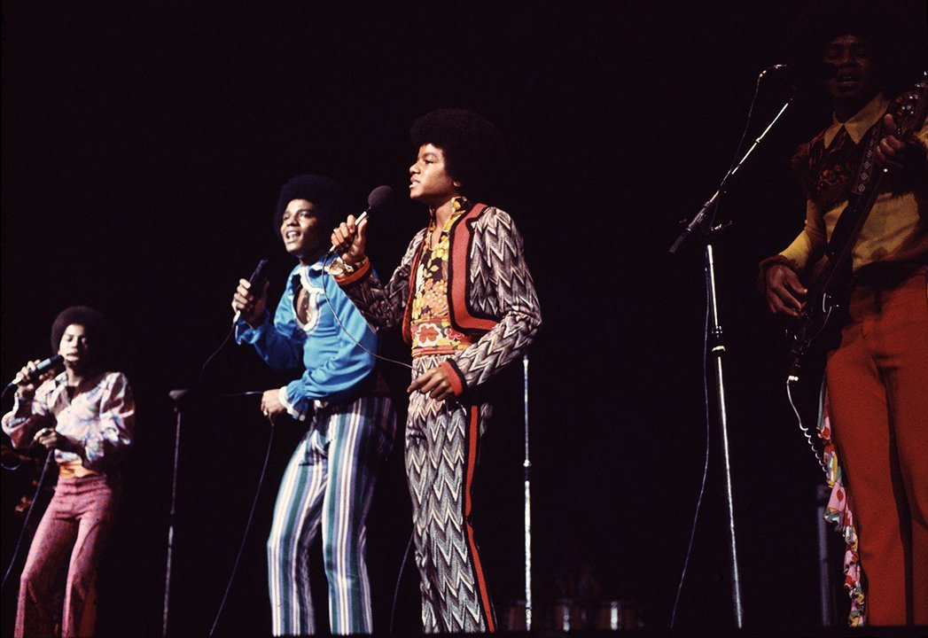 A young Michael Jackson playing with the Jackson Five. I Image: Getty Images.