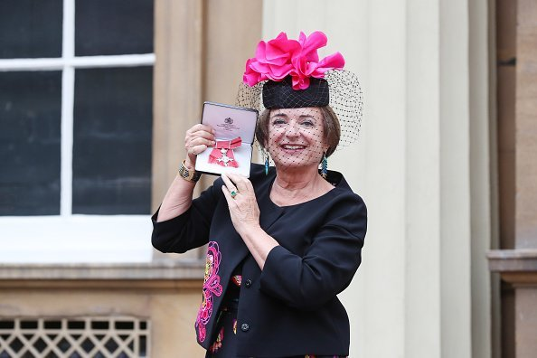 Rosa Monckton, a friend of the late Diana, Princess of Wales, poses for a photo after receiving an MBE by Queen Elizabeth II | Photo: Getty Images