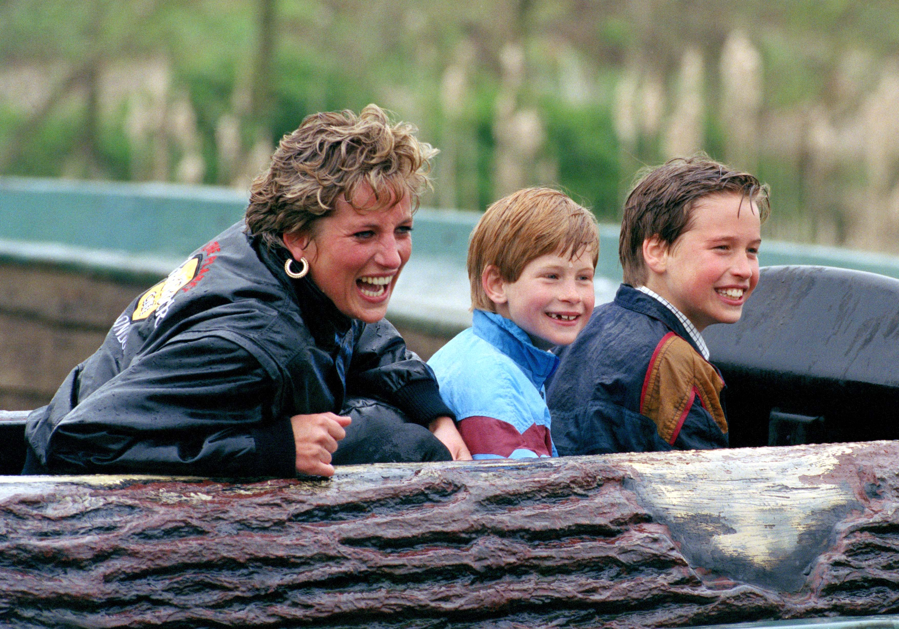 Princess Diana and her sons Prince William and Prince Harry having fun at Thorpe Amusement Park, April, 1993. | Photo: Getty Images.