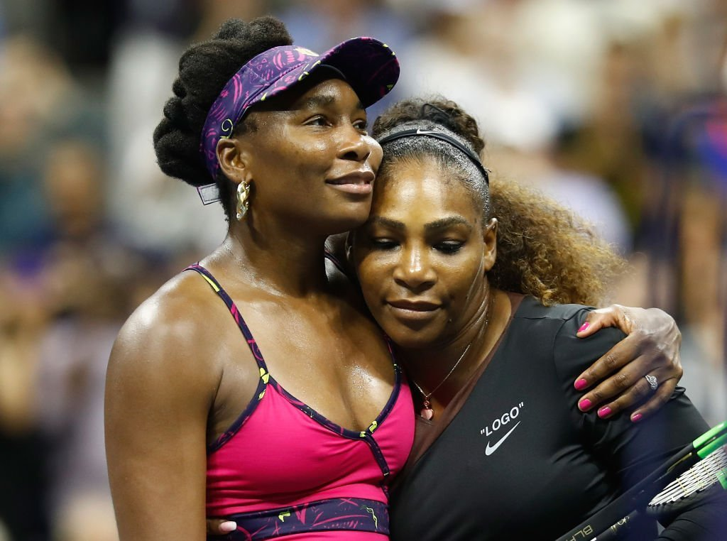 Venus and Serena Williams at the 2018 US Open where they competed against each other. Venus congratulates her sister for winning against her. | Photo: Getty Images