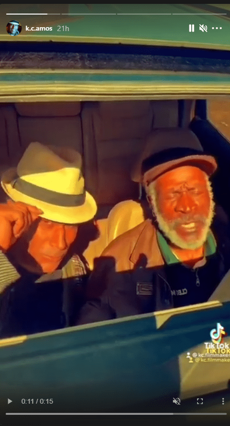 A picture of K.C. Amos and his dad John Amos lip-syncing to a song in the car. | Photo: Instagram/k.c.amos