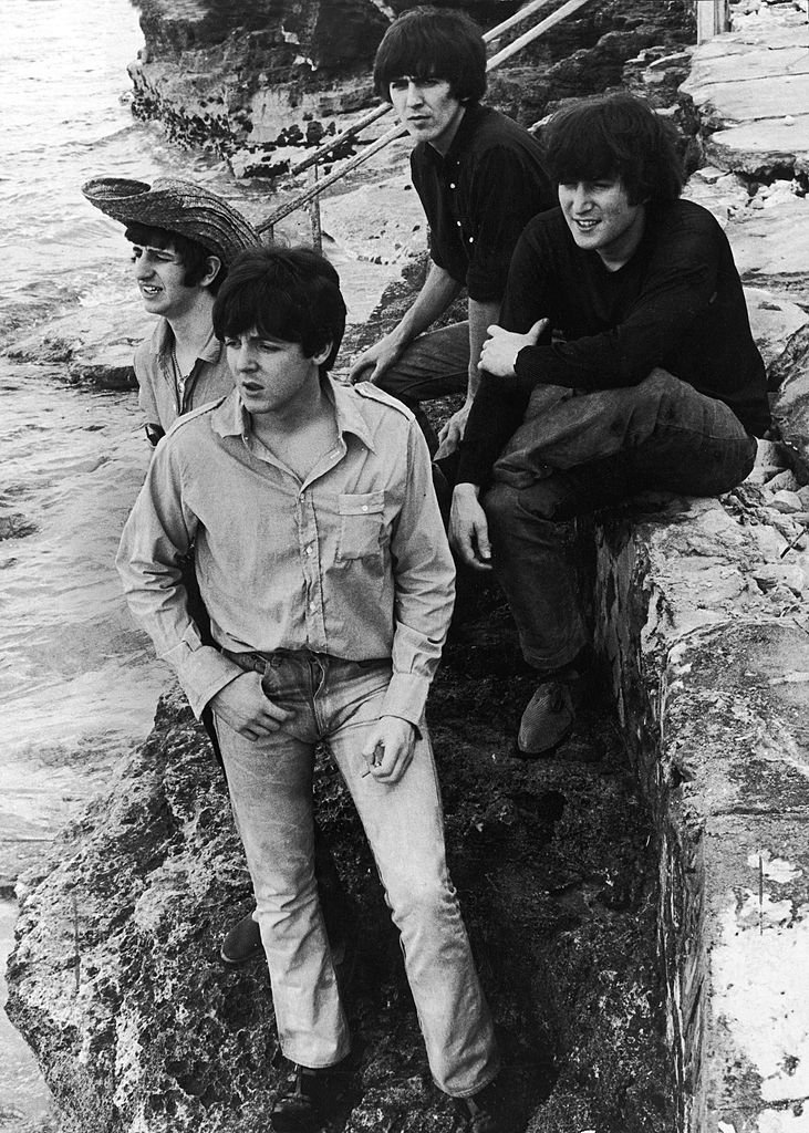 Members of the British rock group The Beatles pose on a sea wall during the filming of their movie, 'Help!,' Nassau, Bahamas, February 26, 1965. | Getty Images / Global Images Ukraine
