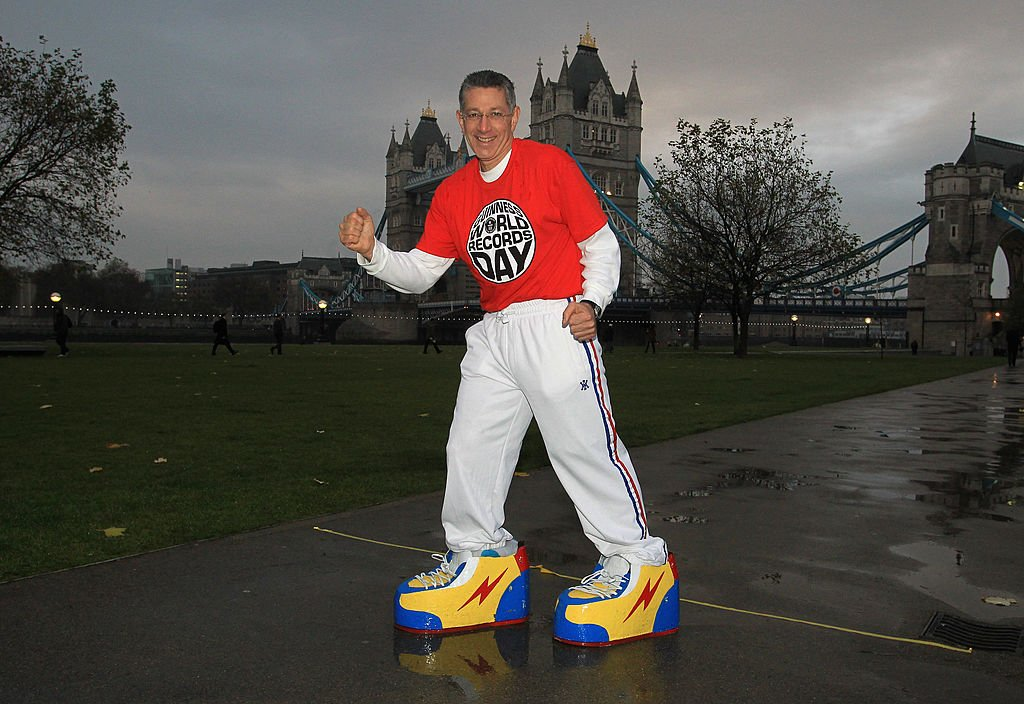 Ashrita Furman during his record attempt 'heaviest shoes walked in' on Guinness World Records day at Pottersfield Park on November 18, 2010 in London, England   Photo: Getty Images