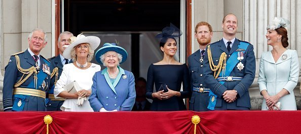 Prince Charles, Camilla, Duchess of Cornwall, Queen Elizabeth II, Meghan, Duchess of Sussex, Prince Harry, Duke of Sussex, Prince William, Duke of Cambridge and Catherine, Duchess of Cambridge watch a flypast to mark the centenary of the Royal Air Force | Photo: Getty Images