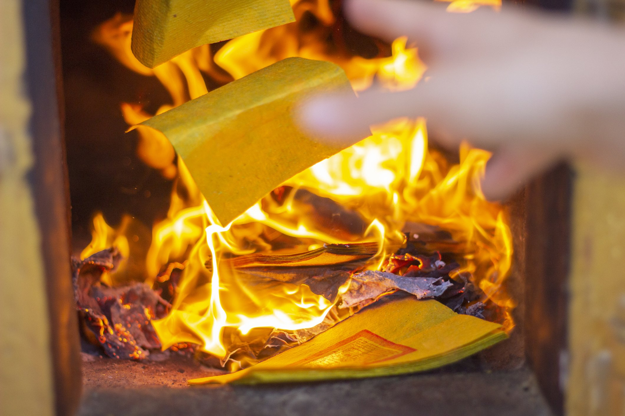 Paper Thrown Into Fire | Photo: Getty Images
