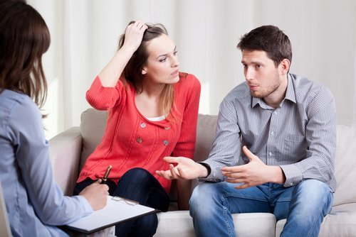 A couple talking to a therapist. | Source: Shutterstock.