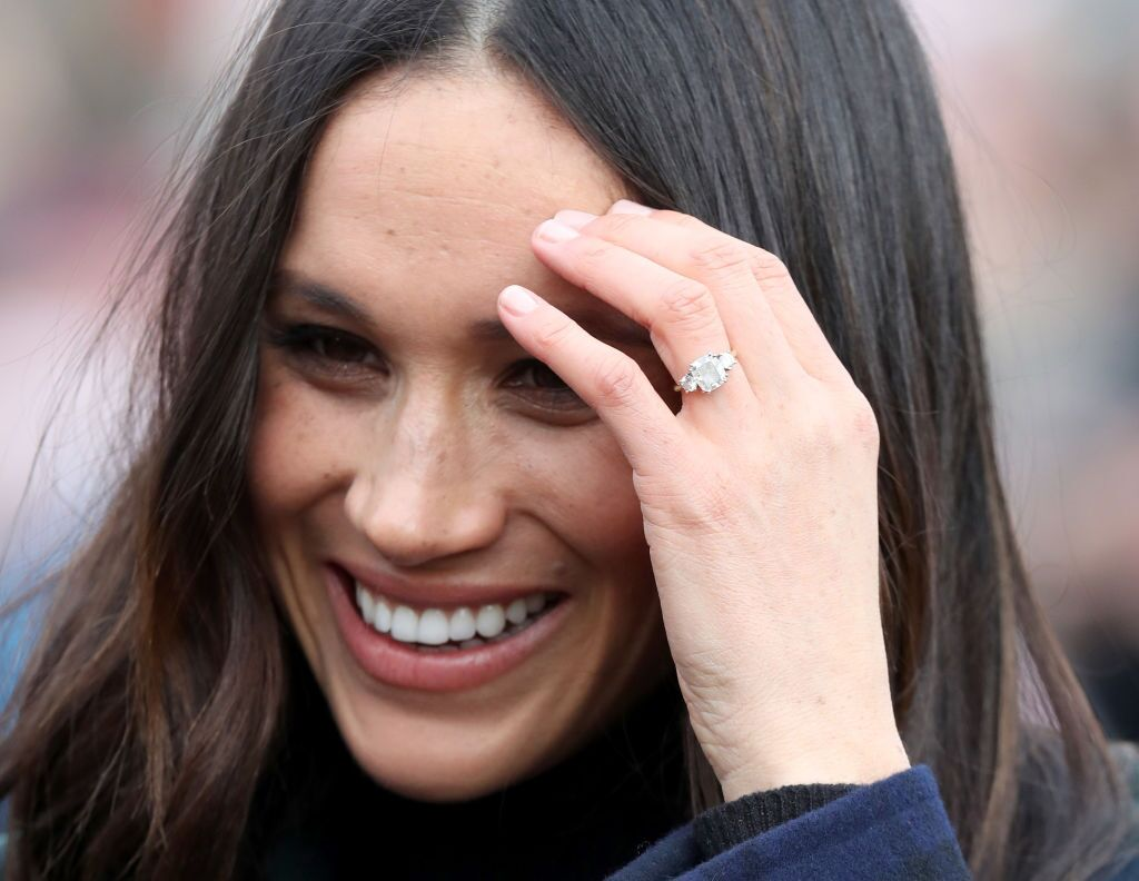 Meghan Markle talks to members of the public as she arrives to Edinburgh Castle with Prince Harry on February 13, 2018 in Edinburgh, Scotland. | Source: Getty Images