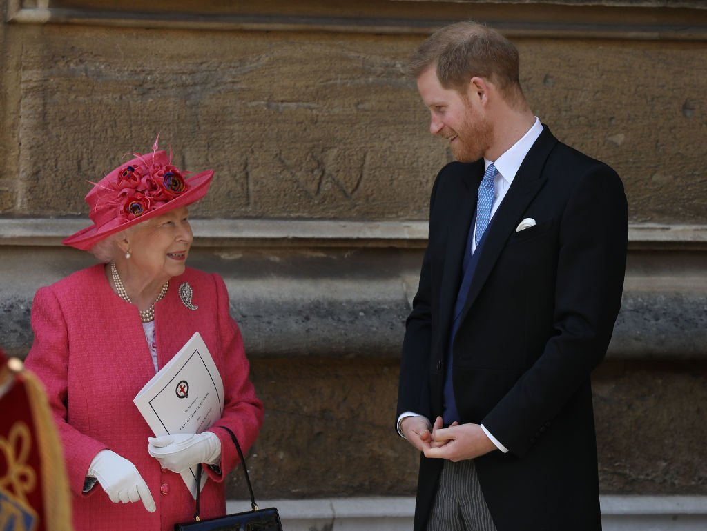 Queen Elizabeth II speaks with Prince Harry, Duke of Sussex as they leave after the wedding of Lady Gabriella Windsor to Thomas Kingston at St George's Chapel, Windsor Castle on May 18, 2019 in Windsor, England | Photo: Getty Images