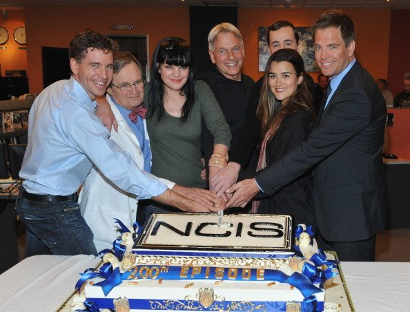 """Brian Dietzen, David McCallum, Pauley Perrette, Mark Harmon, Sean Murray, Cote de Pablo, and Michael Weatherly pose at CBS' """"NCIS"""" celebration of their 200th episode on January 3, 2012 in Valencia, California. 