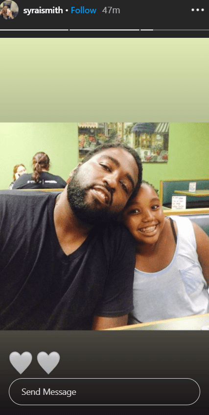 "Syrai Smith leaning to her father Robert ""Big Bert"" Smith inside a restaurant. 