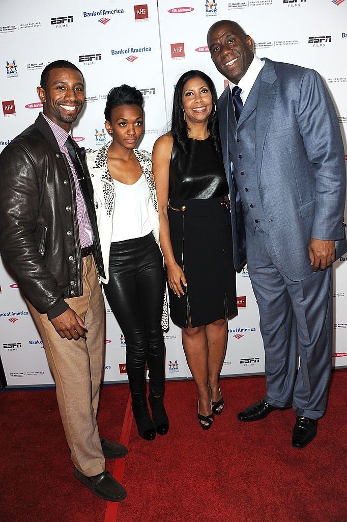 "Children Andre Johnson, Elisa Johnson, wife Cookie Johnson and Earvin ""Magic"" Johnson arrive at the premiere of ESPN Films' ""The Announcement"" at Regal Cinemas L.A. Live  