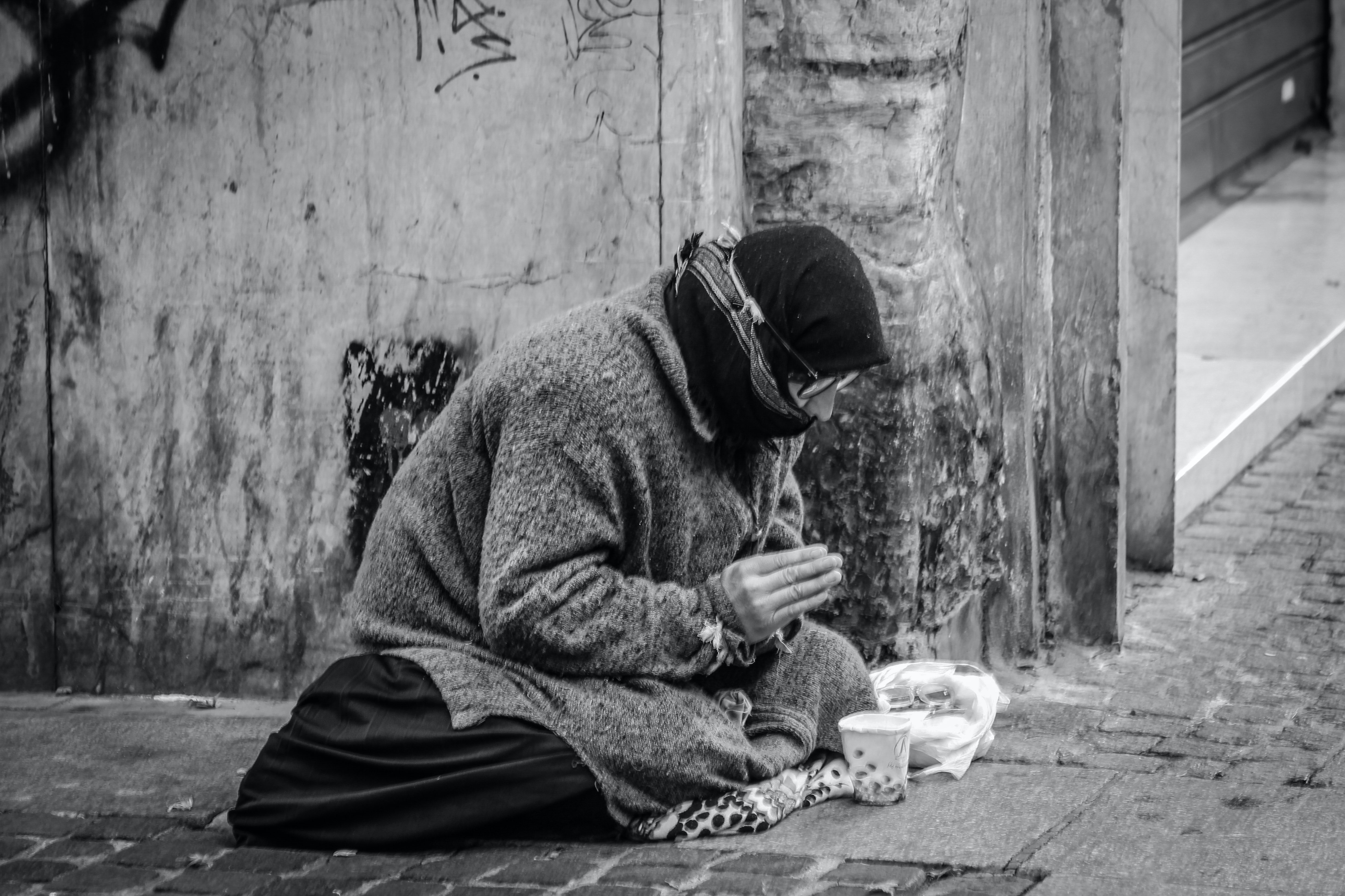 A homeless man on the street.   Pexels/ sergio omassi
