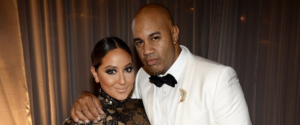 Adrienne Bailon and VP Roc Nation Lenny Santiago at The Inaugural Diamond Ball at The Vineyard on December 11, 2014 | Photo: Getty Images