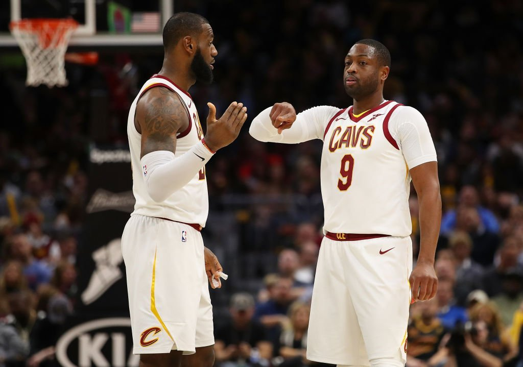 LeBron James #23 of the Cleveland Cavaliers talks with Dwyane Wade #9 while playing the Miami Heat at Quicken Loans Arena | Photo: Getty Images