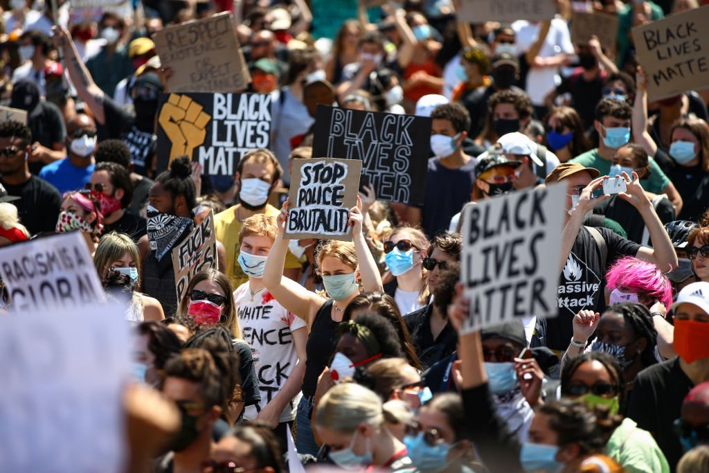 People holding placards as they join a spontaneous Black Lives Matter march at Trafalgar Square on May 31, 2020 | Photo: Getty Images