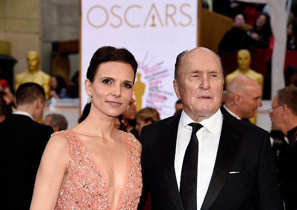 Luciana Pedraza (L) and actor Robert Duvall attend the 87th Annual Academy Awards at Hollywood & Highland Center on February 22, 2015 in Hollywood, California | Photo: Getty Images