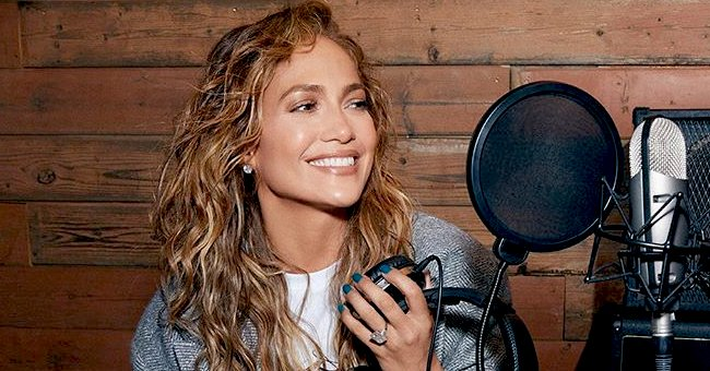 Jennifer Lopez Perfectly Matches Her Makeup with a Blue Satin Jumpsuit as She Debuts New Hair